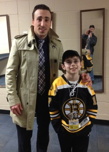 With Bruin Brad Marchand after the game with my Dad in the background taking the photo
