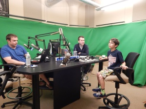 This is the radio room.  The show is video taped online using the green screen.