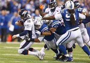 The Colts offense will put on a show to shock Denver, and place them in the loss column.