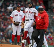(040818 Boston, MA) Boston Red Sox shortstop Xander Bogaerts is helped off the field after he injured his foot during the 7th inning of the game at Fenway Park in Boston on Sunday,April 8, 2018. Staff Photo by Nancy Lane